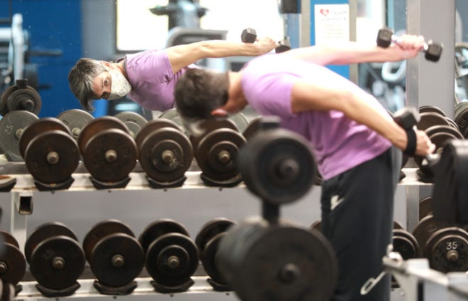 """Linda Blount-Jacobs performs tricep kickbacks at Powerhouse Gym Columbus, 9 E. Long St. in downtown Columbus. She said her best holiday healthy tips are to use moderation and discipline. """"I don't deny myself anything, but I don't go overboard."""" She said she works out three to four times every week."""