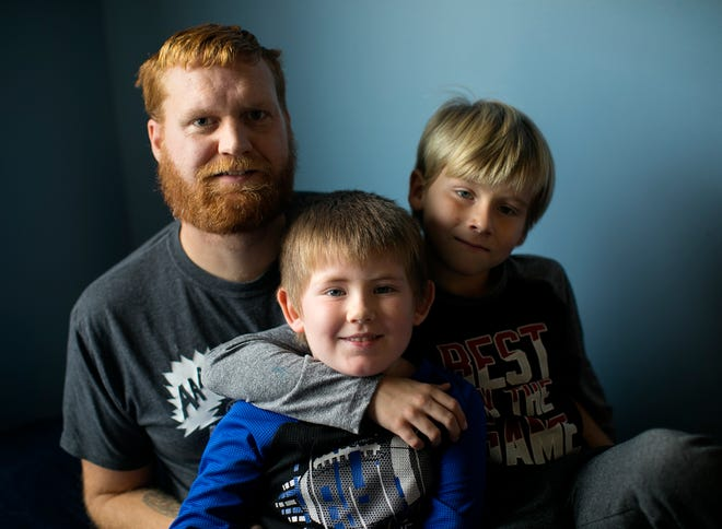 Jared Goddard and his wife, not pictured, are the adoptive parents of siblings Jackob, 8 and Kaiden, 5, photographed at their home in Galloway, Tuesday, November 24, 2020