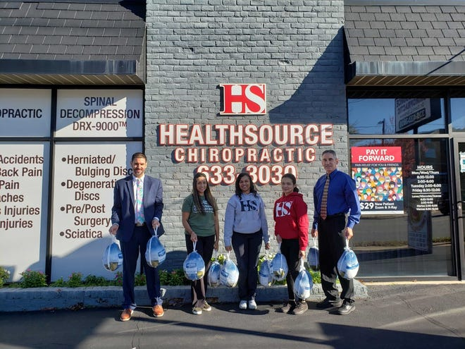 Marcelo Pariz receives 10 turkeys from the staff at HealthSource Chiropratic for a meal being prepared at Our Daily Bread on Wednesday, Nov. 25. Pictured, from left, are Marcelo Pariz, Judith Gonzalez, Kenita Spinks, Gisseth Hernandez and Dr. Darin DeNamur.