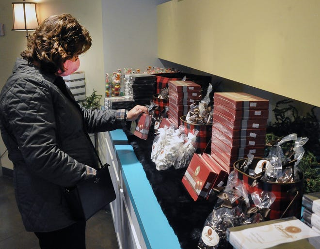 Diana Harris of Ashland does some early holiday shopping at the Coblentz Chocolate Company popup store in downtown Wooster. Main Street Wooster and the Wooster Area Chamber of Commerce are encouraging all holiday shoppers to shop local this season to help businesses negatively impacted by the pandemic.