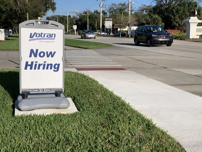 A hiring sign can be seen in front of the offices for Votran, Volusia County's public transportation system, at 950 Big Tree Road in South Daytona on Monday, Nov. 23, 2020.