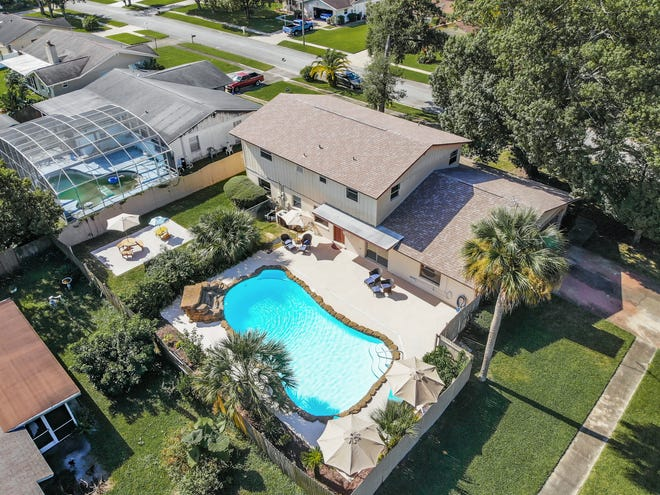 From the big-treed corner lot to the iron-gated front entry porch, this two-story Port Orange pool property will make an ideal family home.