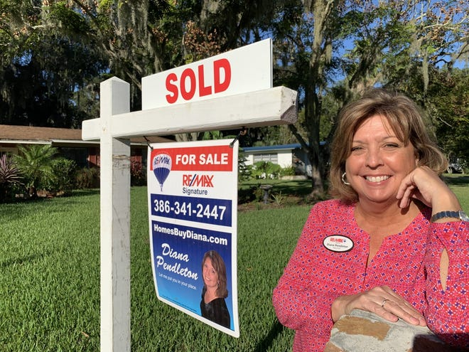 Realtor Diana Pendleton of Re/Max Signature is pictured on Monday, Nov. 23, 2020, in front of a house in South Daytona that was put under contract just five days after she listed it on the market. The pace of home sales picked up in October with the median time to contract shrinking to just 16 days in Volusia County and 22 days in Flagler, according to Realtor association reports.