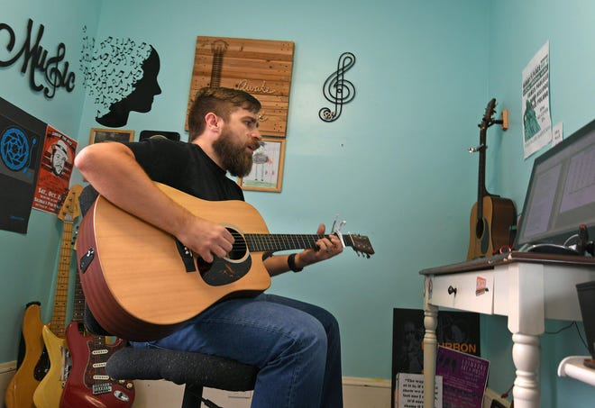 Tony Kellogg, shown at his Cambridge Springs home in 2019, is scheduled to perform this weekend at Altered State Distillery in Erie.