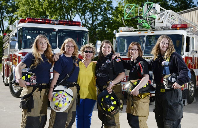 Pam Parker poses with a group of west county volunteer firefighters while reporting a 2016 article for Her Times including, from left: Lindsay Weidler; Jennifer Waxham; Kim Hyde; Stephanie Fox, and Emma Blasius.