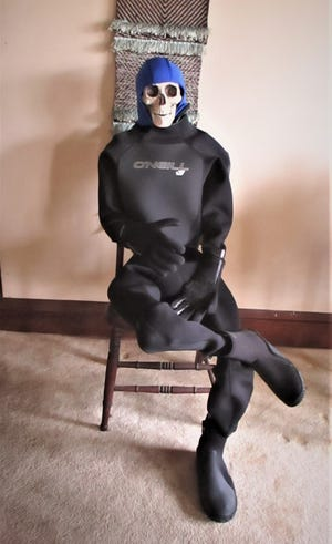 Bare E. Bones is ready to go in his O'Neill Epic wetsuit and Body Glove cap. Booties and gloves also make great gifts.