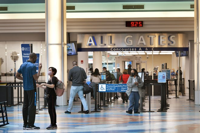 Travelers make their way to their flights at Jacksonville International Airport just ahead of the Thanksgiving holiday.