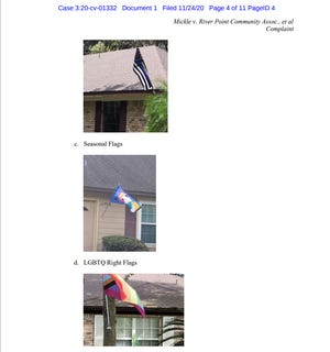 Antoine Mickle's federal lawsuit shows what his flag looks like compared to other flags that were flying in the neighborhood. The homeowners association says Mickle was told to remove his Black Lives Matter flag because it was hanging from his house, even though most of the other flags were similarly hanging from their houses.