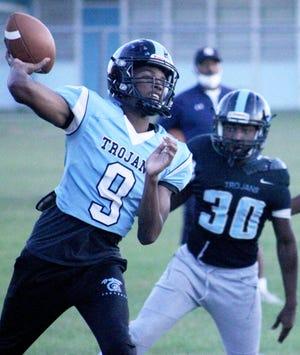 Ribault quarterback Santana Jackson (9) throws a pass downfield during Monday's football practice.
