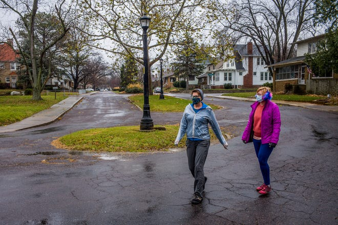 Mary Hosbrough, left, and Jennifer Jacobsen-Wood round a corner Tuesday, November 24, 2020 on W. Eleonor Place in Peoria on the one-year anniversary of the start of their quest to walk every street in the city of Peoria.