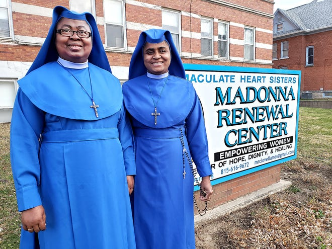 """Sister Mary Theonilla """"Theo"""" Chukwa, left, and Sister Maria NKiruka stand in front of the Madonna Renewal Center on Tuesday, Nov. 17, 2020, in Freeport. There will be a drive-by farewell held for Sister Theo on Sunday, Nov. 29."""