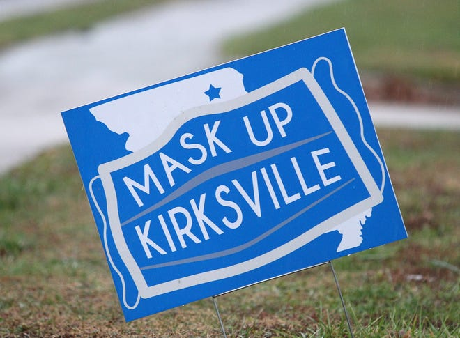 "A ""Mask Up Kirksville"" sign sits along Baltimore Street in Kirksville."
