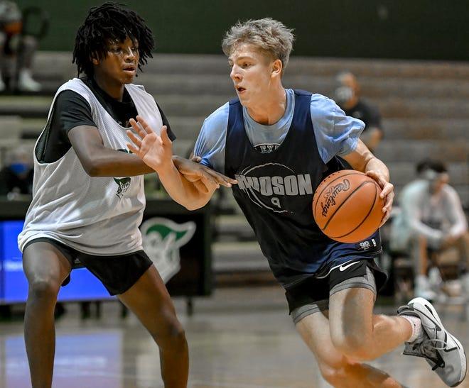 Hudson's Tyler Miller drives to the basket during a scrimmage at Aurora Nov. 10.