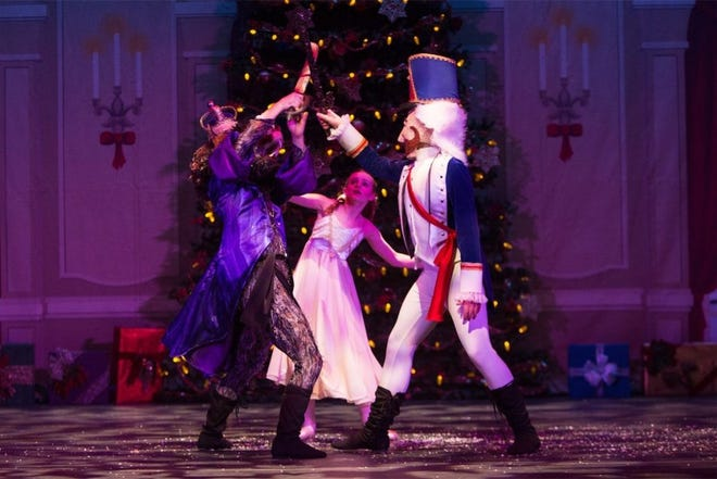 The Nutcracker Prince and the Mouse King battle as Clara looks on in this scene from 'The Nutcracker.'
