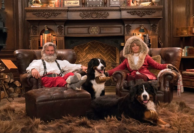 "This image released by Netflix shows Kurt Russell, left, and Goldie Hawn from the holiday film ""The Christmas Chronicles: Part Two,"" which premiered this week on Netflix."