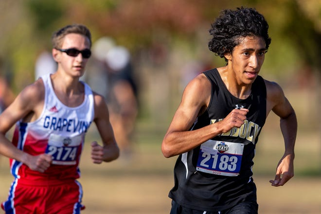 Grapevine's Walker St. John (2174) and Lubbock High's Isaac Alonzo (2183) keep pace during the UIL boys Class 5A state cross country meet Monday at Old Settler's Park in Round Rock. Alonzo, a senior, finished the race in second place with a time of 14 minutes, 44.21 seconds behind St. John.