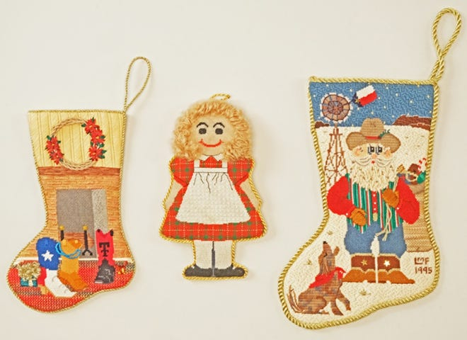 Replicas of Christmas ornaments made by West Texas women that hung on the White House Christmas trees in 1995 and 1997.  Left to right: Fireplace made by Stephani Windham (Mrs. William), Raggedy Ann by Pat Grappe, Santa and windmill by Linda Fisher (Mrs. Charles).