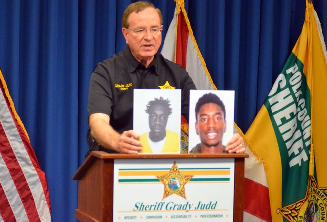 Polk County Sheriff Grady Judd holds up photos of Alfred Higgs Jr., left, and Tarmetris Mack at a press conference on Tuesday. Both are suspects in a fatal shooting that took place at a 7-Eleven in Poinciana on Monday.