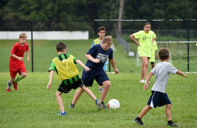 Kids play soccer during a multi-sport summer camp at Highland Park Church in Lakeland in 2017. Thanksgiving break camps are seeing reduced numbers this year due to COVID-19.