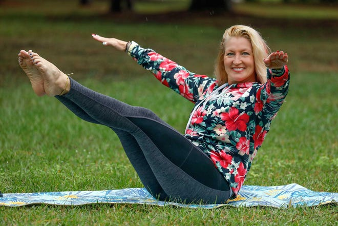 Marlo Alleva demonstrates a boat pose with extended pulsing arms.