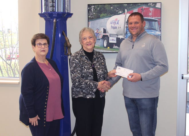 MFA Oil Director of Distribution and Improvement Will Reniker, right, presents a $1,000 donation Monday to Joyce Campbell, center, and the Randolph County Historical Society. The gift was made on behalf of MFA Oil's Business Support Campus, and will go toward historical society services and operations. Joining them is society board member Joyce Meyer.