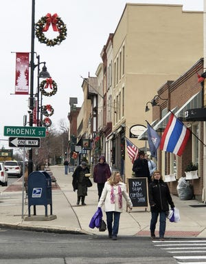 A holiday shopping scene from the days of yore in downtown Canandaigua.