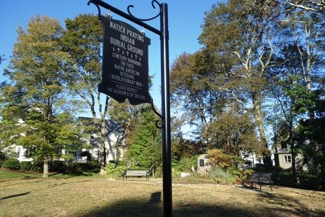 The Indian Burial Ground on Pond Street recently got a new sign and plaque that describes the Praying Indians' role in the American Revolution.
