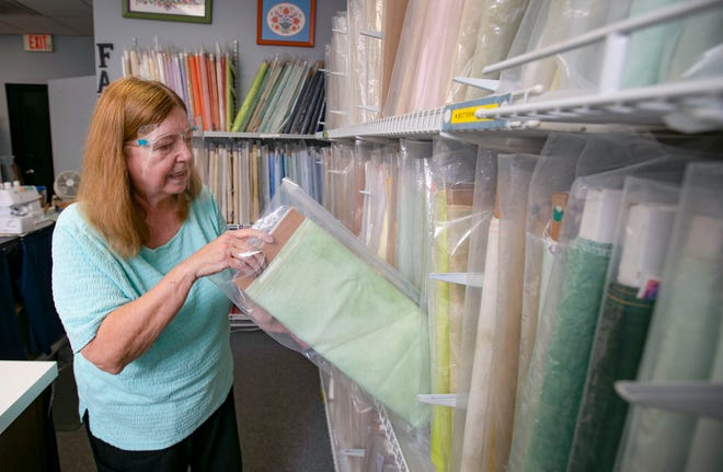 Jean Bendula is shown in her Brick City Cross Stitch shop at the Six Gun Plaza in Ocala on Tuesday. Bendula's shop is one of the few left in Florida. Helping shop owners like Bendula is why Small Business Saturday was launched in 2010.