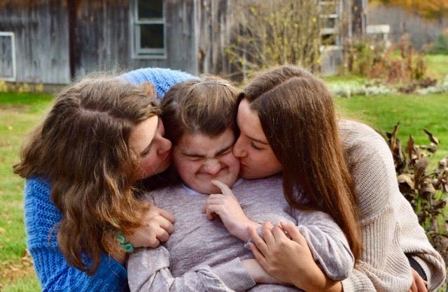 Lexi Gerkin of Brentwood gets a hug from family members. She has Cornelia de Lange syndrome, a genetic disorder, and will require lifetime care.