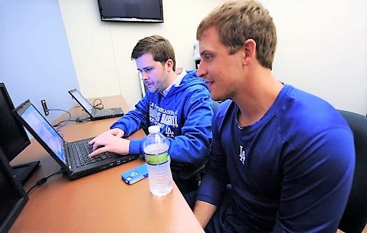 Spaulding High School graduate John Pratt, left, has been with the Los Angeles Dodgers organization since 2011.