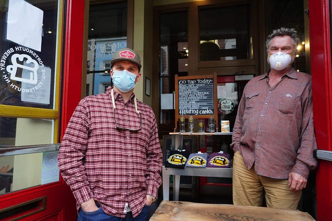 The Portsmouth Brewery will close temporarily following a staff COVID-19 case. Pictured are general manager Patrick Patterson, left, and President Peter Egelston at the beginning of the pandemic.