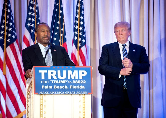 U.S. Secretary of Housing and Urban Development Ben Carson, seen here at a press conference with Donald Trump at Mar-a-Lago, has touted a controversial oleander extract for treating his COVID-19 symptoms.