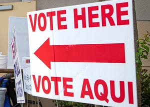 A sign outside a Palm Beach County polling place urges people to vote. [ALLEN EYESTONE/palmbeachpost.com]
