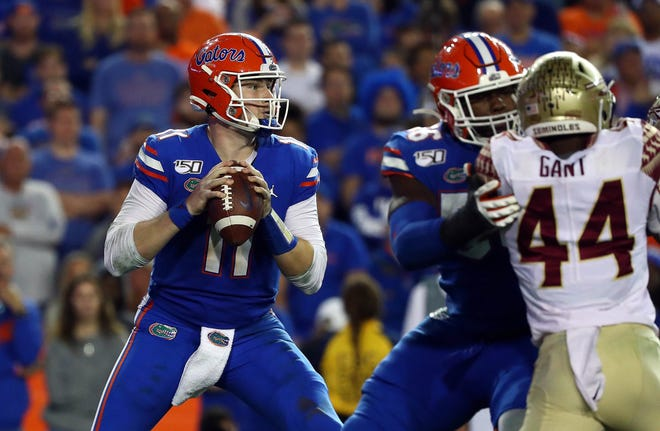 Florida quarterback Kyle Trask (11) drops back against Florida State during last year's game at Ben Hill Griffin Stadium. [Kim Klement-USA TODAY Sports]