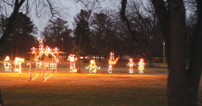 Lights come on for Santa and Mrs. Claus at their special house in Lemon Park, part of the annual Lemon Park Lights drive-through experience. The lights are on every evening at dusk, from now until January 3 in Pratt.
