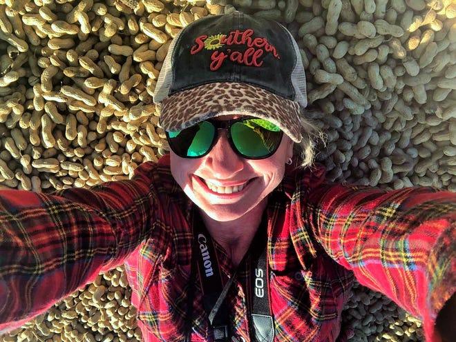 The Social Butterfly Kristi K. Higgins lies in a trailer full of peanuts belonging to farmer Billy Bain in Dinwiddie County on Nov. 7, 2020.