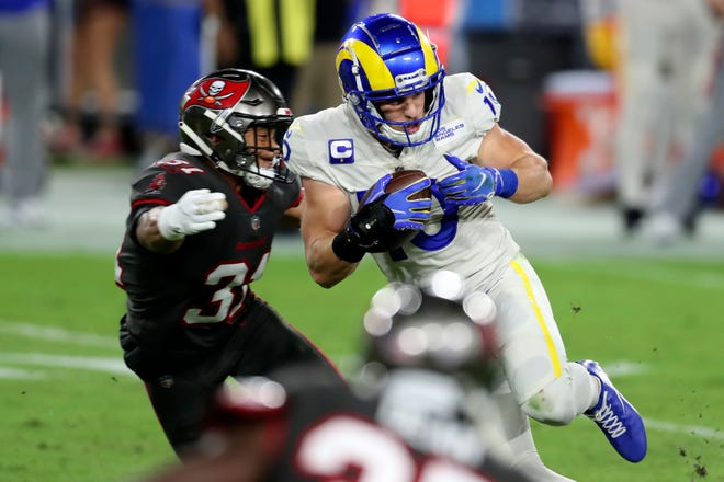 Los Angeles Rams wide receiver Cooper Kupp (10) eludes a tackle by Tampa Bay Buccaneers strong safety Antoine Winfield Jr. (31) after a catch during the first half of an NFL football game Monday, Nov. 23, 2020, in Tampa, Fla. (AP Photo/Mark LoMoglio) ORG XMIT: TPS120