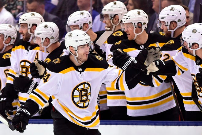 Boston Bruins left winger Jake DeBrusk (front left) celebrates his goal against the Toronto Maple Leafs last April. DeBrusk is hoping to become more consistent with his play even if that means being moved from line to line when the NHL resumes play. [The Canadian Press via AP File Photo/Frank Gunn]