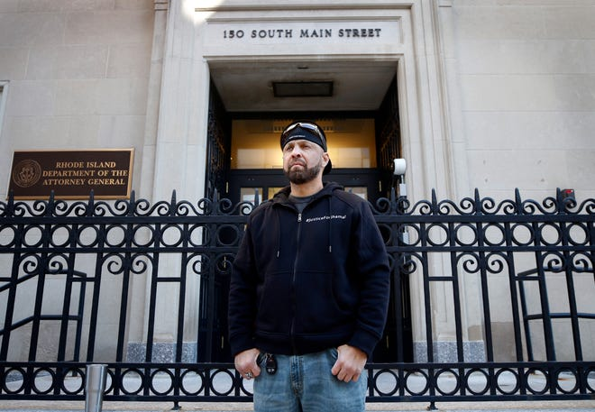 Mark Gonsalves stands in front of the Rhode Island attorney general's office on South Main Street in Providence on Tuesday.