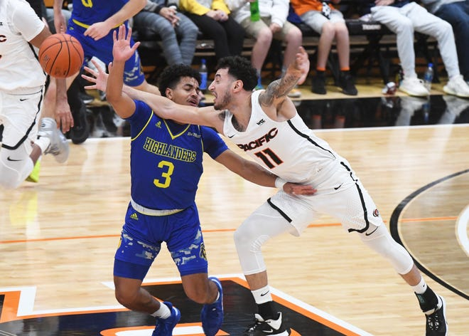 Pacific's Gary Chivichyan goes for a loose ball against UC Riverside's DJ McDonald, during the first half of a game Nov. 17, 2019, at the Spanos Center. The Pacific men's basketball team starts its 2020 season against UC Riverside on Wednesday, Nov. 25 at Spanos Center.