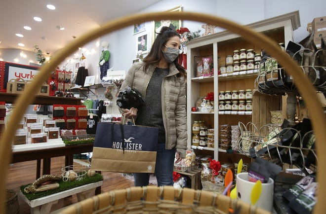Deanna Perciballi of Massillon shops at Blended, a collection of local artists wares avaialable in one shop at Belden Village.