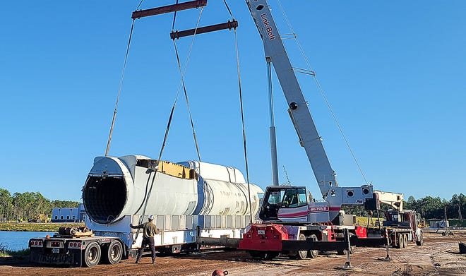 An airplane fuselage donated by Northrop Grumman is prepped for its role at the St. Johns County Sheriff's Office training center, where it will be placed underwater to be used for training divers.