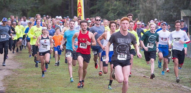 More than 200 runners start the 16th annual Shut Up and Run 5K at Treaty Park in St. Augustine on Thanksgiving morning in 2018.