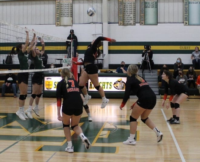 The two local volleyball teams met on the St. Mary's court Friday, Nov. 20 in their final game of the season. Pictured from left: Knights Maddi Mathiowetz and Sydney Windschitl take to the air in an attempt to block a shot from Indian McKenna Strong (center) with teammates Morgan Hoffmann,  Emma Schieffert, and Morgan Klein.