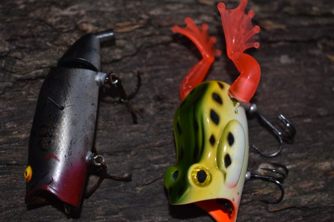 The original mechanical shad lure, left, that Luke has had for over 25 years and the current version named The 22 FIVE mechanical frog, right.