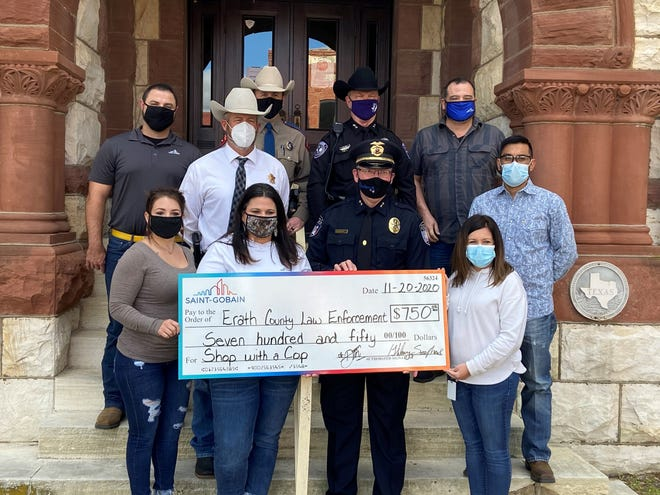 The Stephenville Police Department accepted a donation from Saint-Gobain for the Erath County Shop With A Cop Christmas program. On Monday, Dec. 21, at-risk youth will enjoy breakfast with a law enforcement officer and then be escorted to Walmart with lights and sirens on patrol vehicles to pick out clothes, shoes and a special toy. Donations are being accepted at First Financial Bank or any of the Erath County law enforcement agencies.  Members of the public may also sponsor a child for $150.