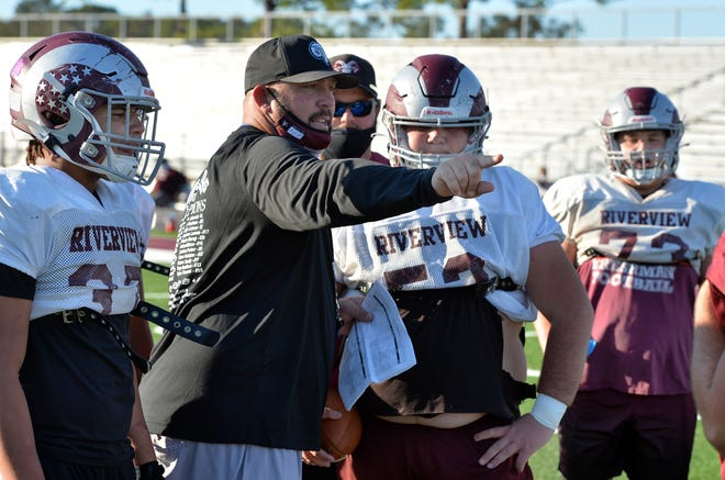Riverview Rams head coach Josh Smithers works with the offensive line during drills Monday as they prepare for their Class 8A-Region 4 semifinal playoff game against Osceola on Friday night.