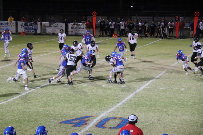 The Chandler Lions' John Marshall (58) wraps up Meeker's JJ Bloomer for no gain Friday night in Chandler.