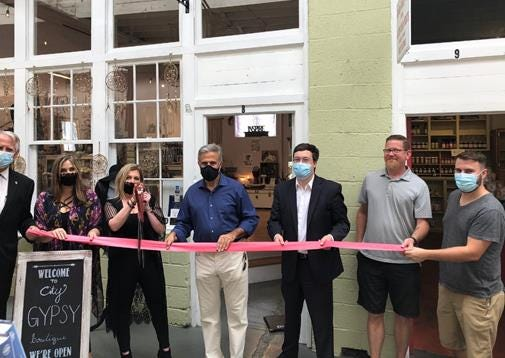 Pictured from left: County Commissioner Rob Zapple, co-owners of City Gypsy Boutique Catrina Tomisch and Ariana Fronti, Mayor Bill Saffo, Wilmington Downtown Inc. chair Dane Scalise, City Market Shops owner Eric Hemmingway, and City Market Shops manager John Blackham.