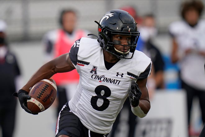 Cincinnati wide receiver Michael Young Jr. runs against Central Florida on Nov. 21. The Bearcats will take on Tulsa in the AAC championship game on Dec. 19. (AP Photo/John Raoux)